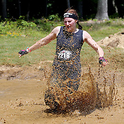 Crystal Desnoyers in action at the mud and water obstacle during the Reebok Spartan Race. Mohegan Sun, Uncasville, Connecticut, USA. 28th June 2014. Photo Tim Clayton
