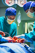 Surgeons in an open operation on a patient in a hospital