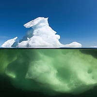 Canada, Manitoba, Churchill, Underwater view of icebergs floating in Hudson Bay on summer afternoon