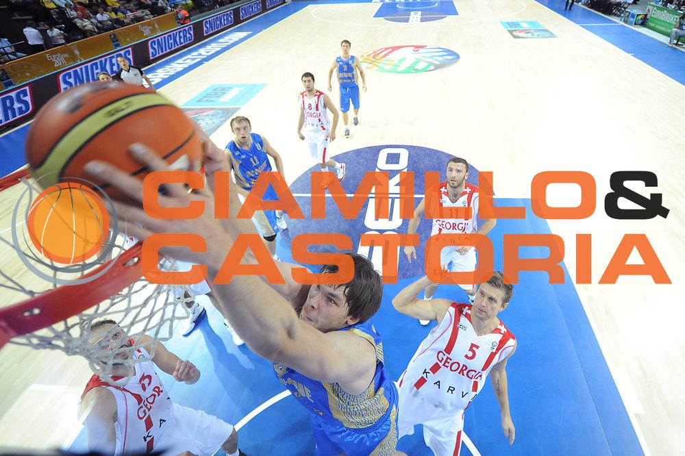 DESCRIZIONE : Klaipeda Lithuania Lituania Eurobasket Men 2011 Preliminary Round Georgia Ucraina Georgia Ukraine<br /> GIOCATORE : Kyrylo Fesenko<br /> SQUADRA : Ucraina Ukraine<br /> EVENTO : Eurobasket Men 2011<br /> GARA : Georgia Ucraina Georgia Ukraine<br /> DATA : 04/09/2011<br /> CATEGORIA : tiro penetrazione special chiacciata<br /> SPORT : Pallacanestro <br /> AUTORE : Agenzia Ciamillo-Castoria/C.De Massis<br /> Galleria : Eurobasket Men 2011<br /> Fotonotizia : Klaipeda Lithuania Lituania Eurobasket Men 2011 Preliminary Round Georgia Ucraina Georgia Ukraine<br /> Predefinita :