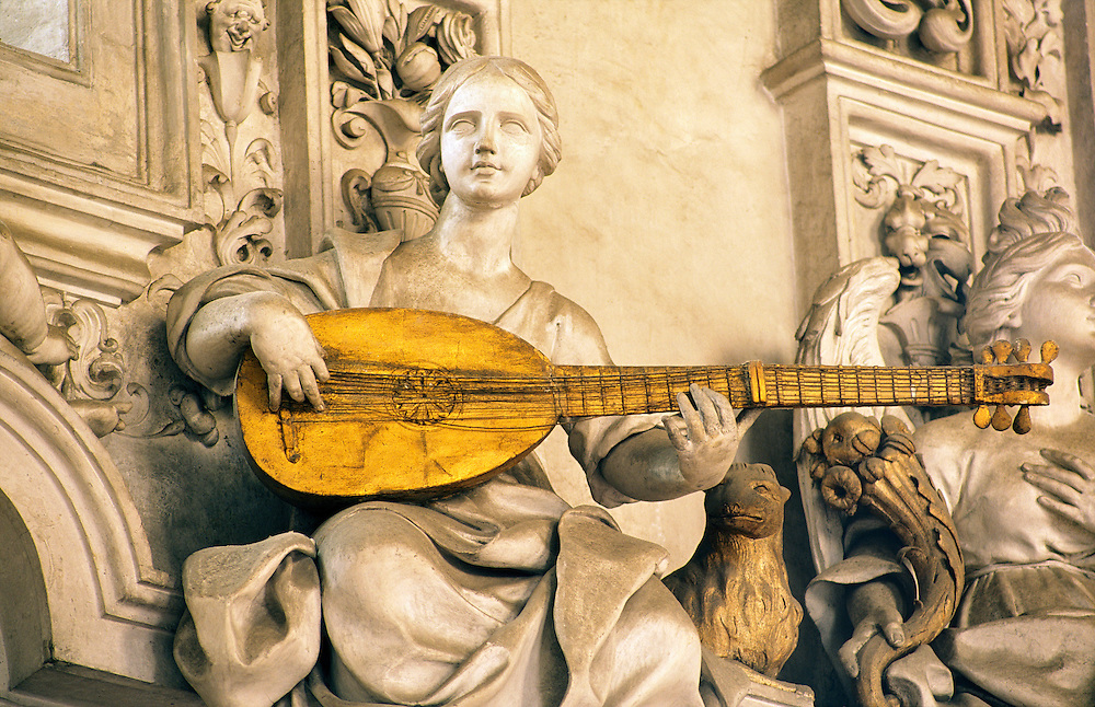 Detail in the Oratorio del Rosario di Santa Zita, Palermo, Sicily, Italy. Stucco work by Giacomo Serpotta. Woman playing lute