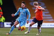 Scott Griffiths of Luton Town (right) and Ryan Donaldson of Cambridge United (left) during the Sky Bet League 2 match at Kenilworth Road, Luton<br /> Picture by David Horn/Focus Images Ltd +44 7545 970036<br /> 31/01/2015