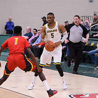 4th year guard Brandon Tull (5) of the Regina Cougars in action during the home game on January  27 at Centre for Kinesiology, Health and Sport. Credit: Arthur Ward/Arthur Images