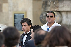 © Licensed to London News Pictures. 27/03/2015. Shah Rukh Khan (pictured left in black suit) filming for his new Bollywood production 'FAN' at Blenheim Palace in Woodstock, Oxfordshire, UK on March 27, 2015. Shah Rukh Khan (Also known as SRK) has appeared in more than 80 Bollywood films and is considered to be one of the worlds biggest film and television stars. Photo credit: Mark Hemsworth/LNP