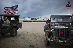 History enthusiasts women in uniform puts on lipstick in front of the ruins of a pontoon on the Normandy coast ahead of the 75th D-Day anniversary, in Arromanches, France, 04 June 2019. World leaders are to attend memorial events in Normandy, France on 06 June 2019 to mark the 75th anniversary of the D-Day landings, which marked the beginning of the end of World War II in Europe.Photo by Eliot Blondet/ABACAPRESS.COM