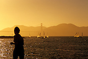 Image of Marina Green Park at sunset with runner and Golden Gate Bridge, San Francisco, California, America west coast