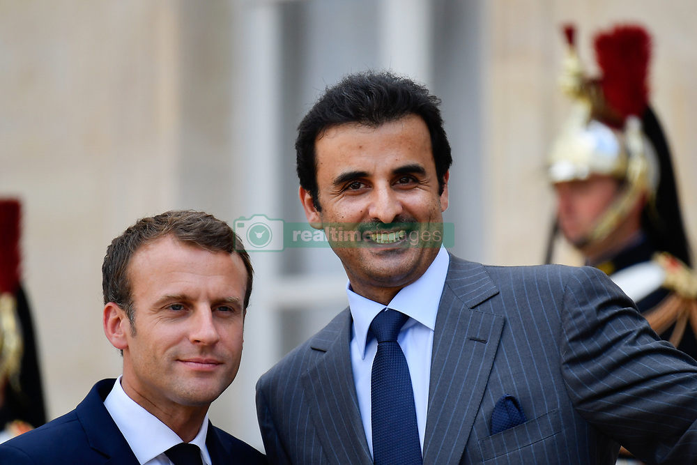 July 6, 2018 - Paris, France - The President of the French Republic, Emmanuel Macron receives Sheikh Tamim bin Hamad Al Thani, Emir of the State of Qatar at the Elysée Palace, in Paris, France on July 6, 2018. (Credit Image: © Julien Mattia/NurPhoto via ZUMA Press)