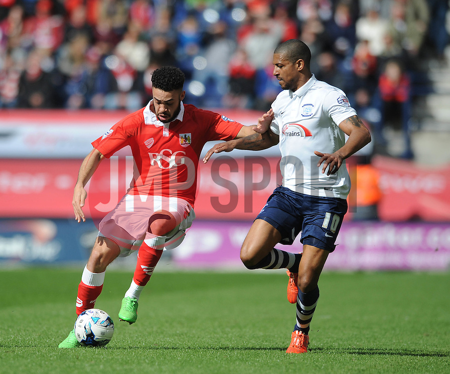 Bristol City's Derrick Williams holds up the ball from Preston North End's Jermaine Beckford - Photo mandatory by-line: Dougie Allward/JMP - Mobile: 07966 386802 - 11/04/2015 - SPORT - Football - Preston - Deepdale - Preston North End v Bristol City - Sky Bet League One