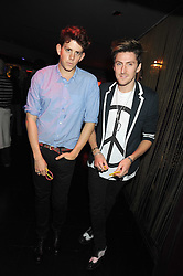 Left to right, TOM GIDDINGS and HENRY HOLLAND at a party hosted by Mulberry at Punk, 14 Soho Square, London on 14th October 2008.