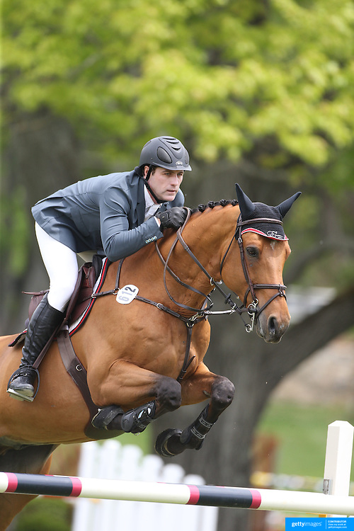 Peter Lutz riding Robin De Ponthual in action during the $35,000 Grand Prix of North Salem presented by Karina Brez Jewelry during the Old Salem Farm Spring Horse Show, North Salem, New York, USA. 15th May 2015. Photo Tim Clayton