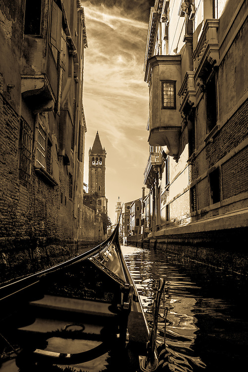 Where: Venice, Italy. Of course I had to go on a gondola. Great experience.
