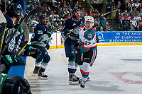 KELOWNA, CANADA - APRIL 26: Turner Ottenbreit #4 of the Seattle Thunderbirds calls for the pass while check by Calvin Thurkauf #27 of the Kelowna Rockets on April 26, 2017 at Prospera Place in Kelowna, British Columbia, Canada.  (Photo by Marissa Baecker/Shoot the Breeze)  *** Local Caption ***