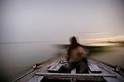 Ganges River boatman at dawn (Varanasi, India).