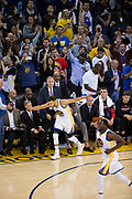 Golden State Warriors guard Stephen Curry (30) celebrates a made basket against the Houston Rockets at Oracle Arena in Oakland, Calif., on March 31, 2017. (Stan Olszewski/Special to S.F. Examiner)