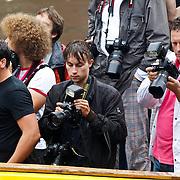 NLD/Amsterdam/20100807 - Boten tijdens de Canal Parade 2010 door de Amsterdamse grachten. De jaarlijkse boottocht sluit traditiegetrouw de Gay Pride af. Thema van de botenparade was dit jaar Celebrate, persboot