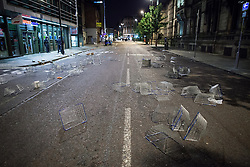 © Licensed to London News Pictures . 10/08/2011 . Manchester , UK . Shopping baskets scattered across Princess Street outside a looted branch of Tesco , as disorder spreads to Manchester during a 4th night of rioting and looting , following a protest against the police shooting of Mark Duggan in Tottenham . Photo credit : Joel Goodman/LNP