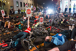 October 31, 2016 - London, London, UK - LONDON, UK.  Campaign group, 'Stop Killing Cyclists' hold a die in protest in the road at Lavender Hill in south London at the spot where cyclist, Lucia Ciccioli was killed following a collision with a Heavy Goods Vehicle (HGV) lorry one week ago. Cycling groups and their supporters are campaigning and calling for the Mayor of London, Sadiq Khan to ban HGV's from the capital. (Credit Image: © Vickie Flores/London News Pictures via ZUMA Wire)