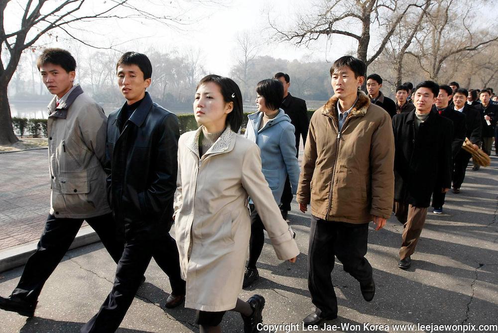 North Korean university students walk near the Mankyongdae, the house where the late leader Kim Il-sung was born, in Pyongyang. Photo by Lee Jae-Won (NORTH KOREA) www.leejaewonpix.com/