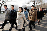 North Korean university students walk near the Mankyongdae, the house where the late leader Kim Il-sung was born, in Pyongyang. Photo by Lee Jae-Won (NORTH KOREA) www.leejaewonpix.com/