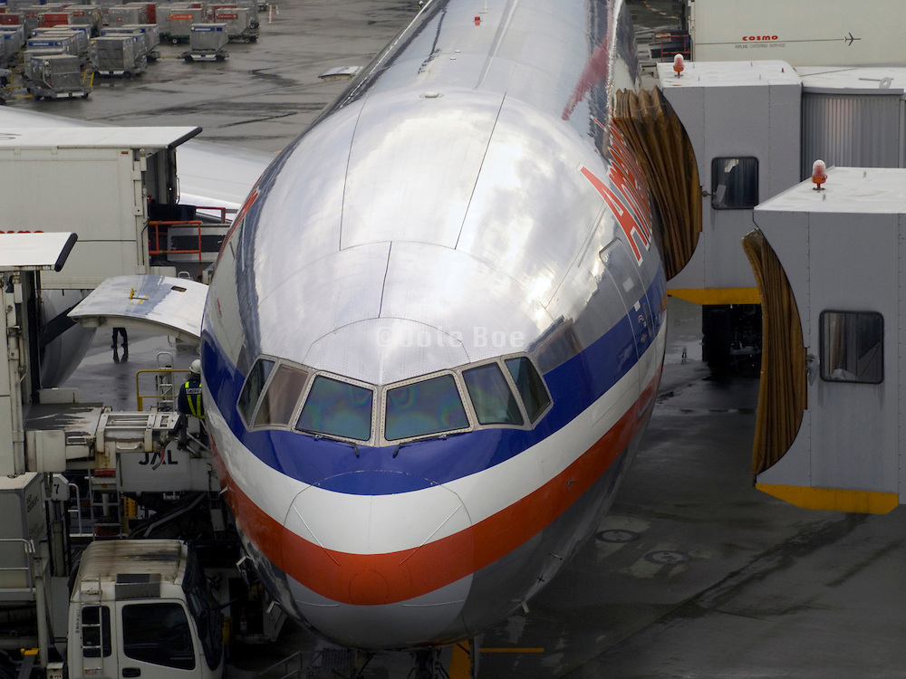 An American Airline airplane being serviced