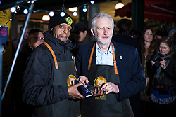 © Licensed to London News Pictures. 14/12/2017. London, UK. Labour Leader JEREMY CORBYN joins Adan Abobaker, recipient of the Queen's Gallantry Medal, at the Change Please coffee cart in Borough Market where he works, which supports people out of homelessness. Photo credit: Rob Pinney/LNP