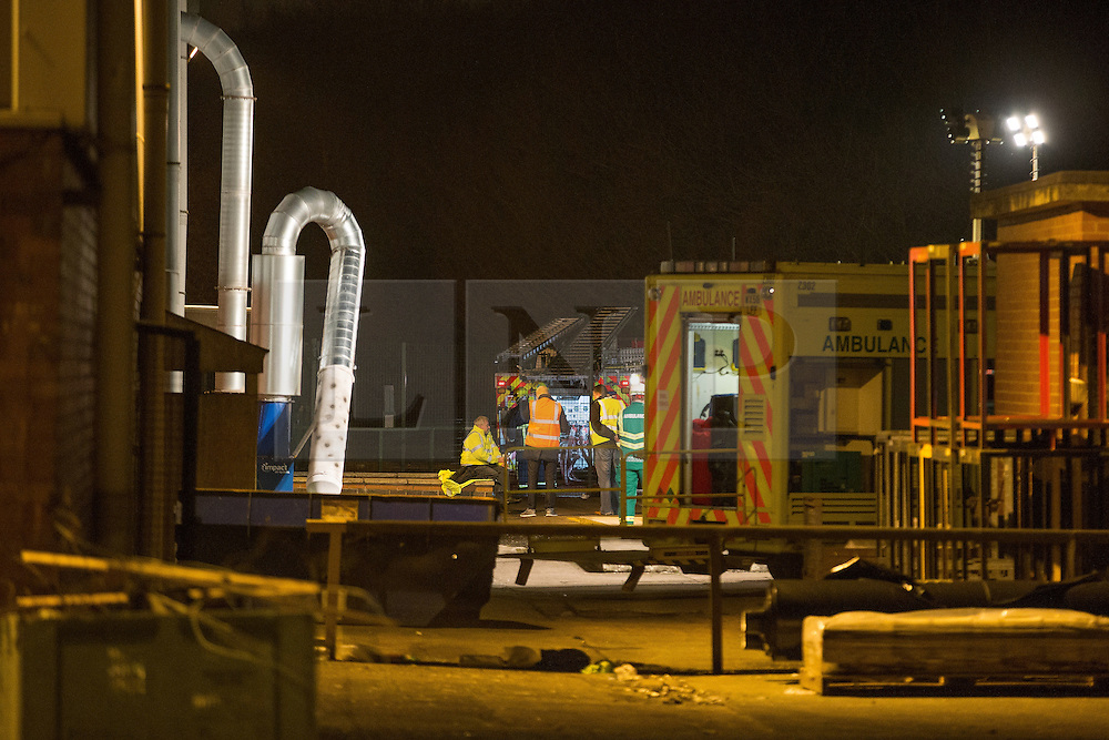 "© Licensed to London News Pictures . 15/03/2015 . Salford , UK . Emergency services at the back of the eco park . Roads are closed and people have been evacuated as a large fire burns at a unit within "" Junction Eco-Park "" in Clifton , Greater Manchester , this evening (Sunday 15th March 2015) . The smoke and flames can be seen for many miles . Forty fire fighters are at the scene working to control the blaze . Photo credit : Joel Goodman/LNP"