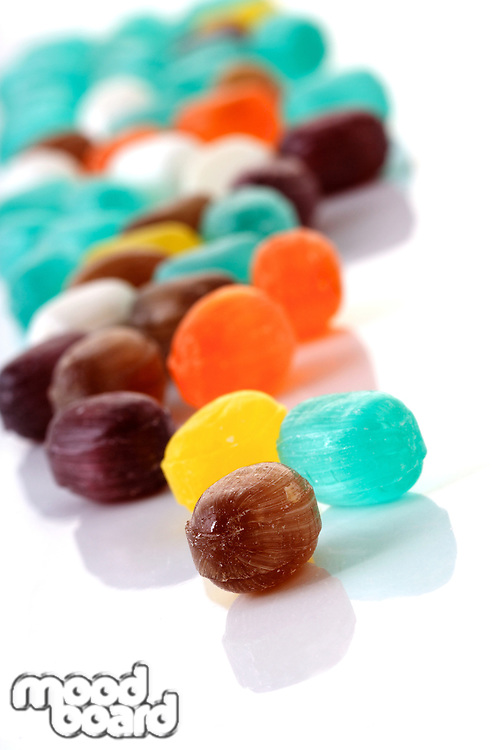 Close up of candies on white background