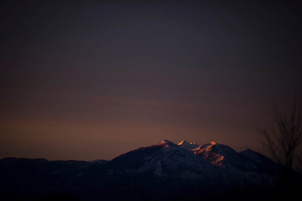 The Sunrise lights up the mountains in Provo, Utah before the Holi Festival of Colors, on Saturday, Mar. 24, 2012. (Photo by Benjamin B. Morris ©2012)