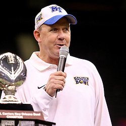 Dec 20, 2009; New Orleans, LA, USA; Middle Tennessee State Blue Raiders head coach Rick Stockstill stands next to the trophy following a win in the 2009 New Orleans Bowl at the Louisiana Superdome. Middle Tennessee State defeated Southern Miss 42-32. Mandatory Credit: Derick E. Hingle-US PRESSWIRE