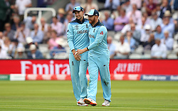 England's Joe root (left) celebrates catching out Australia's David Warner with team mate Jonny Bairstow (right) during the ICC Cricket World Cup group stage match at Lord's, London.