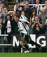 Photo: Andrew Unwin.<br /> Newcastle United v Everton. The Barclays Premiership. 24/09/2006.<br /> Newcastle's Shola Ameobi (R) celebrates his goal with James Milner (L).