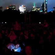 July 13, 2013 - New York, NY : People crowd the Great Lawn in Central Park on Saturday evening to watch the New York Philharmonic's performance in the free MLB All-Star Charity Concert to benefit Hurricane Sandy victims on July 13, 2013.  Pop star Mariah Carey (not pictured) made a guest appearance. <br /> CREDIT: Karsten Moran for The New York Times