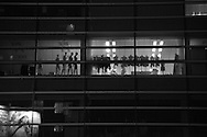 June 11, 2016: Late at night mannequins in Tokyo's Aoyama district are illumintaed by janitors cleaning the offices. Aoyama is at the heart of Japan's fashion and design culture, and trendsetter for Japan cool. Photo by Torin Boyd.