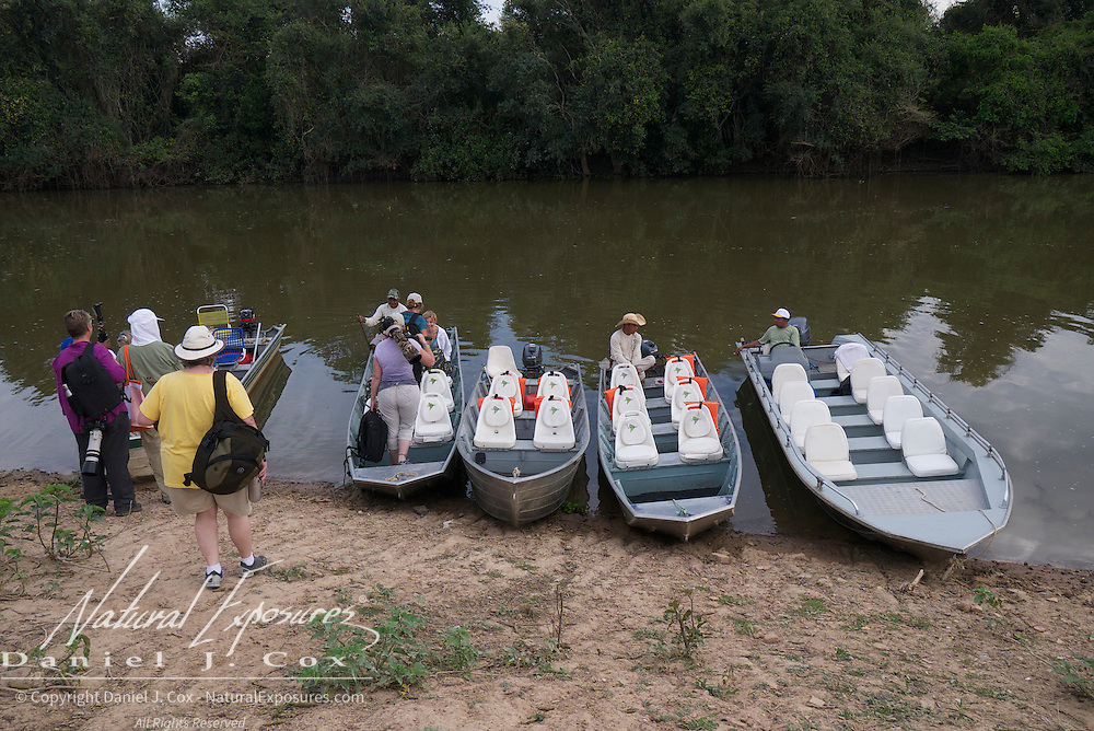 Tourists boarding boats on the Rio Pixaim River, Pantanal, Brazil.