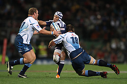 CAPE TOWN, SOUTH AFRICA - 11 JUNE 2011, Stormers wing Gio Aplon attempts to get through Rossouw de Klerk of the Bulls and Flip van der Merwe of the Bulls during the Super Rugby match between DHL Stormers and the Bulls held at DHL Newlands Stadium in Cape Town, South Africa..Photo by Shaun Roy / Sportzpics.net