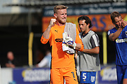 AFC Wimbledon goalkeeper George Long (1) clenching fist during the EFL Sky Bet League 1 match between AFC Wimbledon and Doncaster Rovers at the Cherry Red Records Stadium, Kingston, England on 26 August 2017. Photo by Matthew Redman.