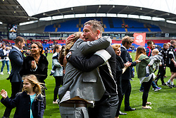 Free to use courtesy of Sky Bet - Bolton Wanderers manager Phil Parkinson hugs Lee Anderson, son of Chairman Ken Anderson, as Bolton Wanderers celebrate finishing the season as Sky Bet League One runners up to secure automatic Promotion to the 2017/18 Sky Bet Championship - Rogan Thomson/JMP - 30/04/2017 - FOOTBALL - Macron Stadium - Bolton, England - Bolton Wanderers v Peterborough United - EFL Sky Bet League One.
