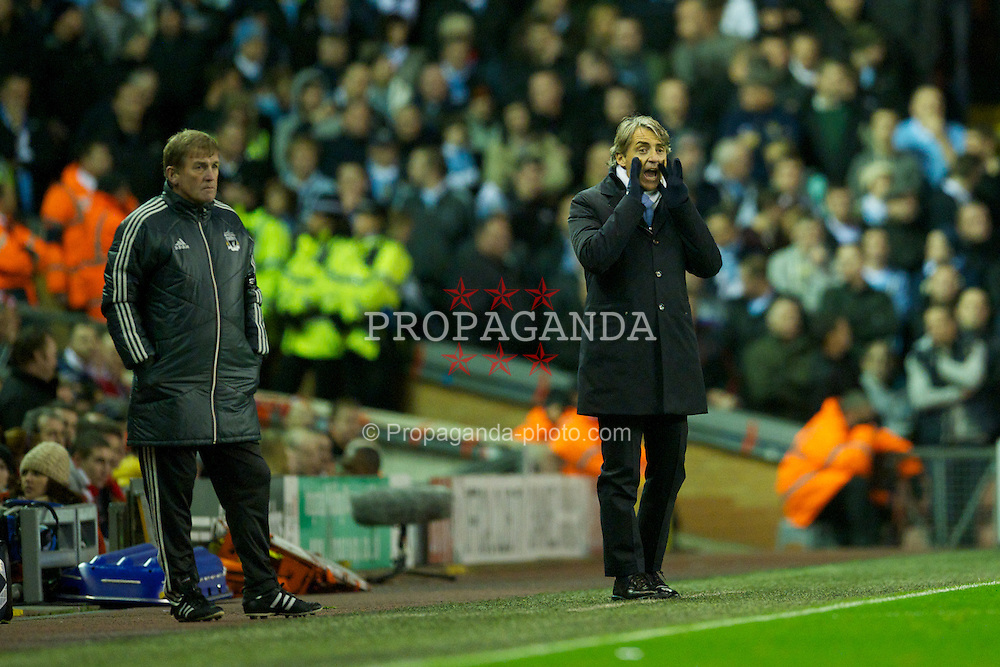 LIVERPOOL, ENGLAND - Sunday, November 27, 2011: Manchester City's manager Roberto Mancini and Liverpool manager Kenny Dalglish during the Premiership match at Anfield. (Pic by David Rawcliffe/Propaganda)
