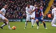 Joe Ledley takes on the Liverpool defence during the Barclays Premier League match between Crystal Palace and Liverpool at Selhurst Park, London, England on 6 March 2016. Photo by Michael Hulf.