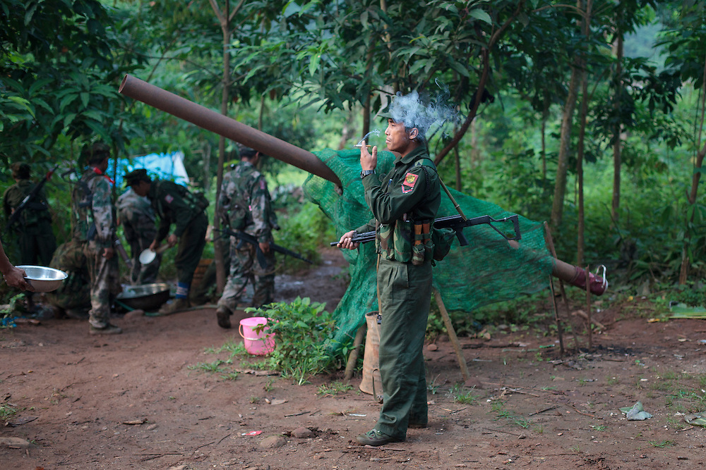 A KIA's soldier smoke a cigarette in front of a home-made cannon in the Rubber Hill Post in the front line of Laja Yang village outskirts of Laiza, Kachin State, Myanmar on August 8, 2012, most of the Kachin people are Christians. The KIA formed in 1961 in response to a military coup in Burma led by General Ne Win, who attempted to consolidate Burmese control over regions on the periphery of the state which were home to various ethnic groups. From 1961 until 1994, the KIA fought a grueling and inconclusive war against the Burmese junta. In 2011, general Sumlut Gun Maw confirmed renewed fighting in the state of Kachin for independence. One of the new reasons for the ending of the ceasefire is the creation of the Myitsone Dam which requires the submergence of dozens of villages in Kachin state.