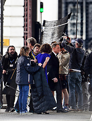 "© Licensed to London News Pictures. 30/05/2015. London, UK. Filming for the new James Bond film ""Spector"" with Daniel Craig (centre) and Naomie Harris (blue dress) at the courtyard of the UK Government Treasury building in Westminster, London . Photo credit: Ben Cawthra/LNP"