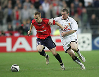 Photo: Lee Earle.<br /> Lille v Manchester Utd. UEFA Champions League.<br /> 02/11/2005. Manchester United's Wayne Rooney (R) chases Matthieu Chalme for the ball.
