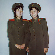 NORTH KOREA POLAROIDS<br /> <br /> Photographer Eric Lafforgue first went in North Korea in 2008. At this time, there was no mobile phone in the country, and the only pics people were taking were thanks to the official photographers who stood at the entrance of the main monuments, to sell some photo souvenirs to visitors. <br /> 	<br /> I first thought about making Polaroids just as a kind of artistic work, to keep the dull colors of this country, but quickly i discovered this camera was the best way to make contacts with locals and to break the ice.<br /> <br /> Everytime i was taking a polaroid, i was taken another one i offered to my north korean « model ».<br /> <br /> So many times, this allowed me to see north koreans in a very different way, and to start some conversations, thru my guide, of course. Something that was no allowed in 2008.<br /> <br /> I think the ones who loved the most the Polaroids were the soldiers ! At the DMZ, the whole unity stood one by one in front of the camera. First the colonel did not want to allow me to disturb the mission they had : monitoring South Korea. But when i did one of a soldier, he came back and ordered me to take one for him !<br /> Another colonel lead me to the top of the DMZ building to pause : he wanted to show his wife where he was working.<br /> It was so funny to see them lose the stiff attitud they are supposed to keep everytime.<br /> <br /> When visiting some houses, i asked the people where they wanted to stand for the picture, everybody answered « below the dear leaders  portraits». Once, i had to do the Polaroid again as the Leaders portraits were cut. Unacceptable.<br /> <br /> For many, they had never see the development of a Polaroid, specially in the countryside where the only pics people own are the ones of the Dear Leaders (an obligation by the way !). So when i gave Polaroids to farmers, they were really happy. One of them even offered me 1 peach to thank me. In 2008, it was a very valuable gift for a north korean. They were the first fruits i saw in  my15 days tour…<br /> <br /> In Pyongya