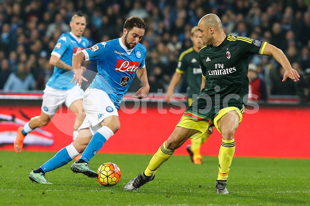 Gonzalo Higuain of Napoli and Alex of AC Milan during the Serie A TIM match between Napoli and AC Milan at Stadio San Paolo, Naples, Italy on 22 February 2016. Photo by Alfredo Panico.