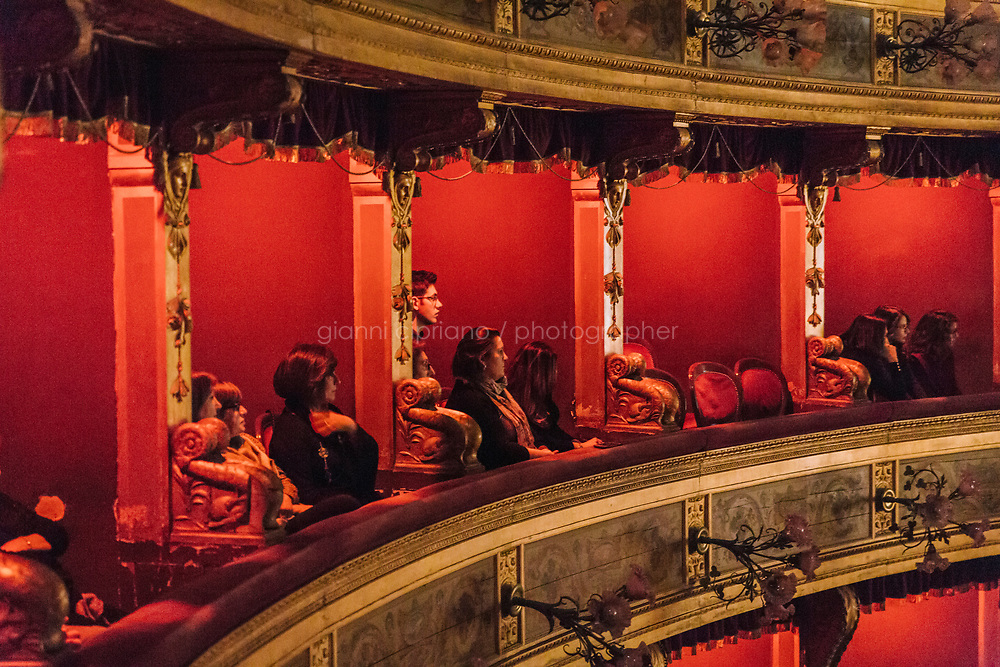 PALERMO, ITALY - 18 FEBRUARY 2018: The audience (mostly composed of family and friends of the performers) watches the dress rehearsal of &quot;Don Quixote&quot; at the Teatro Massimo in Palermo, Italy, on February 18th 2018.<br /> <br /> The Teatro Massimo Vittorio Emanuele is an opera house and opera company located  in Palermo, Sicily. It was dedicated to King Victor Emanuel II. It is the biggest in Italy, and one of the largest of Europe (the third after the Op&eacute;ra National de Paris and the K. K. Hof-Opernhaus in Vienna), renowned for its perfect acoustics. It was inaugurated in 1897.
