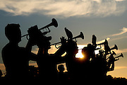 The trumpet section is silhouetted against the setting sun during an afternoon practice on the Tiger Band practice field November 7, 2006.