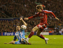 Liverpool, England - Wednesday, October 3, 2007: Liverpool's Fernando Torres and Olympique de Marseille's Gael Givet during the UEFA Champions League Group A match at Anfield. (Photo by David Rawcliffe/Propaganda)