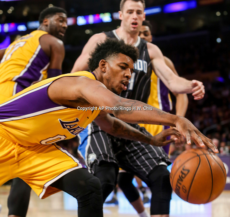 Los Angeles Lakers  forward Nick Young tries to save a ball against Orland Magic during the first half of an NBA basketball game Tuesday, March 8, 2016, in Los Angeles.  (AP Photo/Ringo H.W. Chiu)