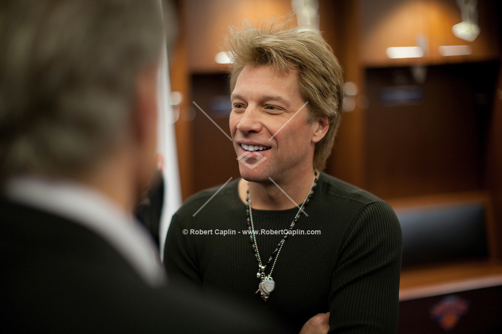 "Jon Bon Jovi at a meet-and-greet. ""12-12-12?, a fundraising concert to aid the victims of Hurricane Sandy, will take place on December 12, 2012 at Madison Square Garden. The concert featured The Rolling Stones, Bon Jovi, Eric Clapton, Dave Grohl, Billy Joel, Alicia Keys, Chris Martin, Bruce Springsteen & the E Street Band, Eddie Vedder, Roger Waters, Kanye West, The Who, and Paul McCartney. All the proceeds went go to the Robin Hood Relief Fund. Robin Hood, the largest independent poverty fighting organization in the New York area, will insure that every cent raised will go to non-profit groups that are helping the tens of thousands.of people throughout the tri-state area who have been affected by Hurricane Sandy...Photo © Robert Caplin.."