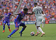 FC Cincinnati defender Alvas Powell (92) and New England Revolution forward Cristian Penilla (70) fight for the ball and position during a MLS soccer game, Sunday, July 21, 2019, in Cincinnati, OH. The Revolution defeated FC Cincinnati 2-0.(Jason Whitman/Image of Sport)